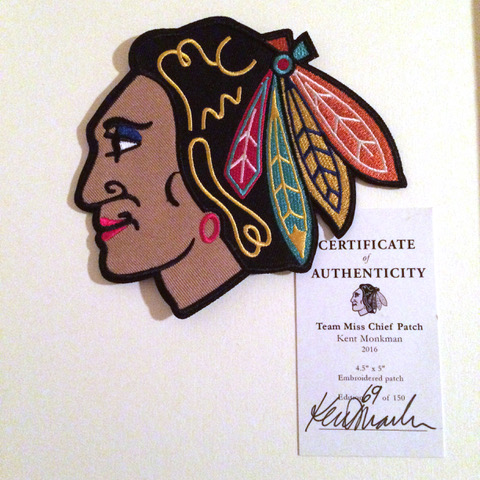 This embroidered patch resembles the Chicago Blackhawk's logo which depicts the side profile of an Indigenous Chief. To resemble the artist's alter ego Miss Chief Eagle Testickle, Monkman has embroidered overtop the face blue eyeshadow, red lipstick, and a red hoop earring. This patch is number 69 in an edition of 150.