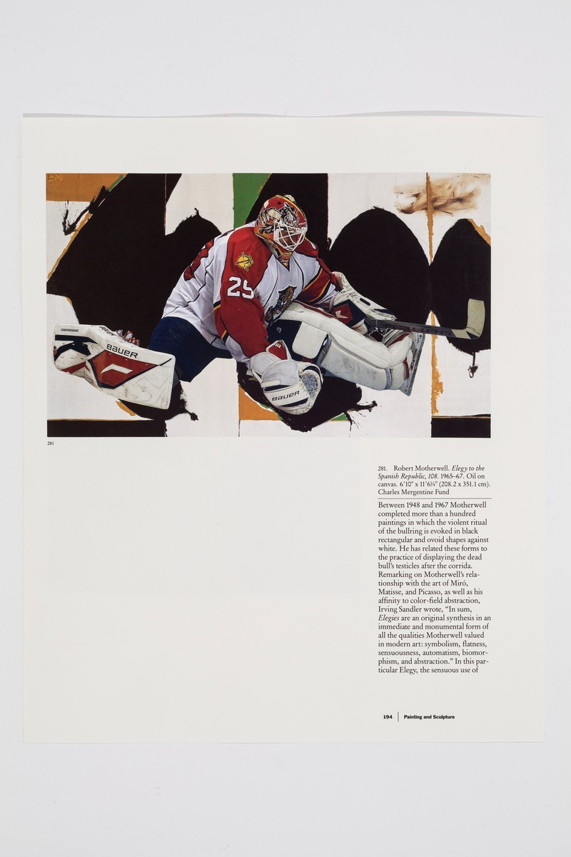 Close-up photo of the image on the far left of the display. The hockey image takes up the top third of the page, showing goalie Mike Vernon wearing a white and red jersey. His legs are splayed out to the sides and his stick is outstretched in his left hand to defend the goal. His image is collaged overtop a reproduction of Robert Motherwell's painting entitled Elegy to the Spanish Republic from 1965-1967. Below, on the far right side of the image is a text column that describes Motherwell's painting.