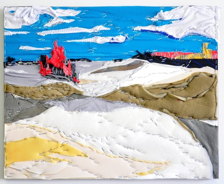 This is a collaged winter landscape made up of recycled hockey equipment depicting a blue sky and a snow-covered field created from recycled hockey equipment, in particular jersey material and pad foam