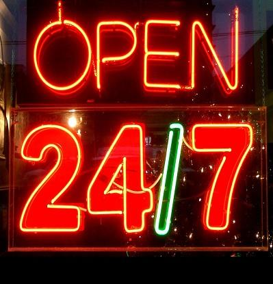 Glowing neon sign stating boldly, open 24/7