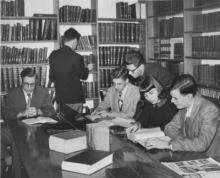A group of people studying in a Library