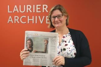 Julia Hendry hold a copy of The Record issue in which she is featured