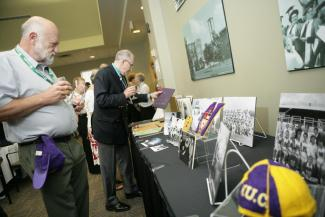 Guests at the Founders' Lunch peruse Laurier artifacts